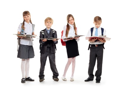 Group of cheerful children standing with books  Isolated over white  photo