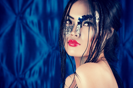 fantasy makeup: Portrait of an asian model with fantasy make-up.  Stock Photo