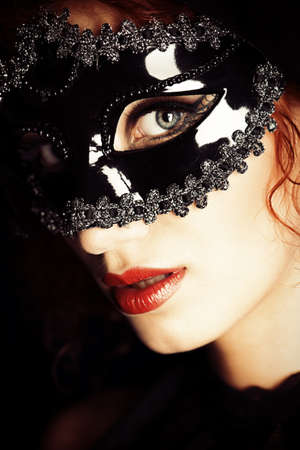 Beautiful elegant woman in carnival mask. photo