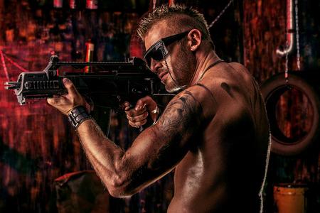 army man: Portrait of a handsome muscular soldier man holding a machine gun