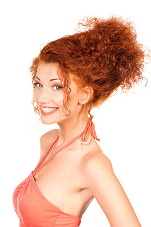 Cheerful young woman with beautiful red curly hair. Isolated over white.  photo