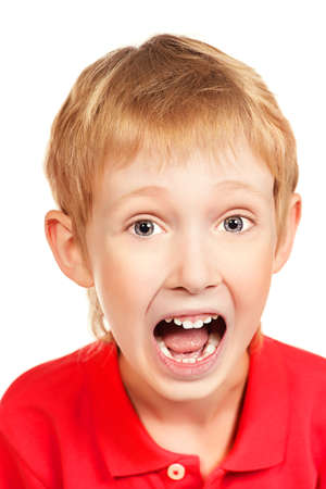 Portrait of a shouting boy. Isolated over white background. photo