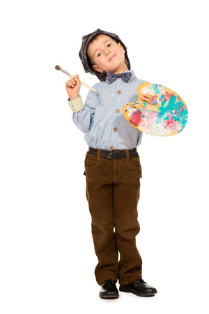 Little boy playing a painter. Different occupations. Isolated over white. photo