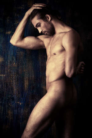 Sexual muscular nude man posing over dark background. Stock Photo - 23291970
