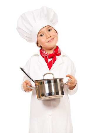ladle: Portrait of a little boy cook holding pan with a ladle. Different occupations. Isolated over white background.