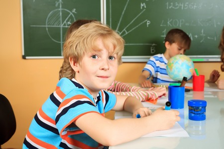 kids class: School children studying in classroom. Education.