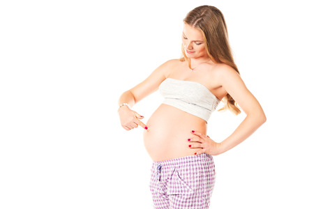 Beautiful pregnant woman. Isolated over white.
