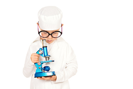 Portrait of a cute smiling boy playing a doctor with microscope. Different occupations. Isolated over white. photo