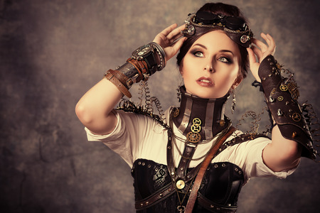 Portrait of a beautiful steampunk woman over grunge wall. Stock Photo - 23456128