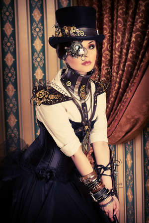 Portrait of a beautiful steampunk woman over vintage wall. Stock Photo - 23473476