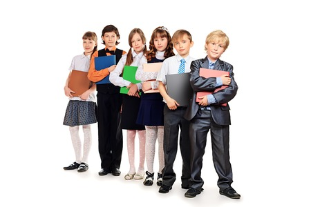 Group of cheerful children standing with books. Isolated over white. photo