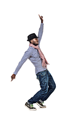 Full length portrait of a modern african american young man dancing at studio. Isolated over white. photo