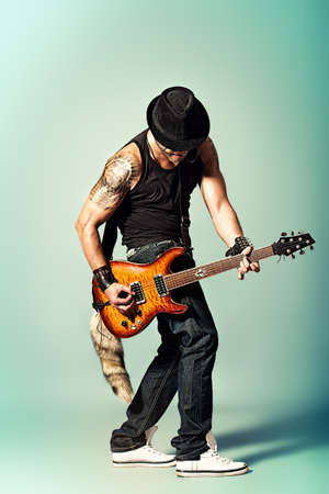 harmonist: Rock musician is playing electrical guitar.