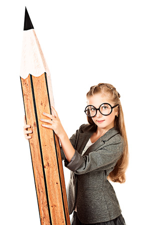 Portrait of a cute ten years girl in spectacles holding a huge pencil. Education. Isolated over white. photo