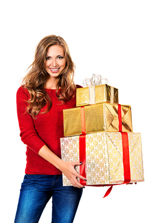 Beautiful young woman holding gifts. Isolated over white. photo