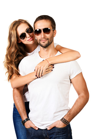 Happy young couple in love posing at studio. Isolated over white. Stock Photo - 23665497