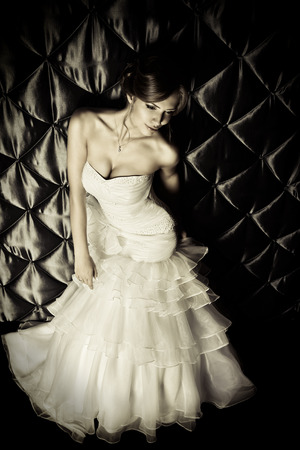 blackandwhite: Full length portrait of a beautiful charming bride in a luxurious dress. Black-and-white.