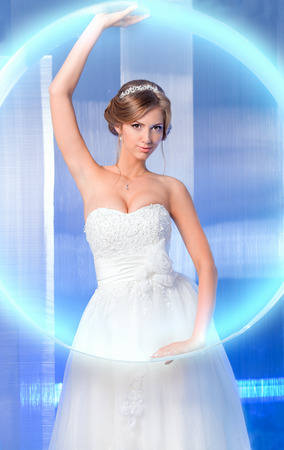 Portrait of a beautiful charming bride. High-tech style. Stock Photo