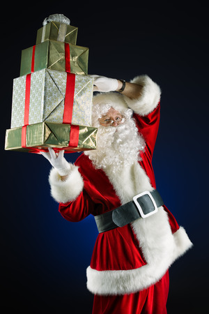 Portrait of a traditional Santa Claus with Christmas gifts.  photo