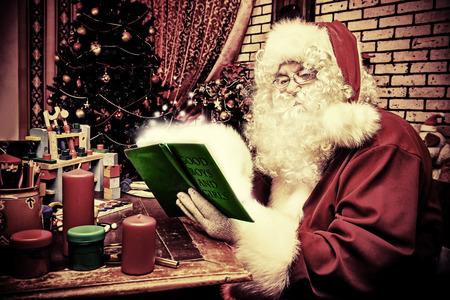 Santa Claus making Christmas gifts at home. Stock Photo - 23668349