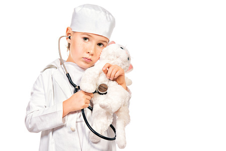 Little boy playing a doctor veterinarian. Different occupations. Isolated over white. photo