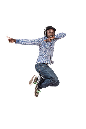 Modern african american young man jumping at studio. Isolated over white. photo