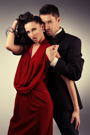 Portrait of a beautiful young couple in love posing at studio. photo