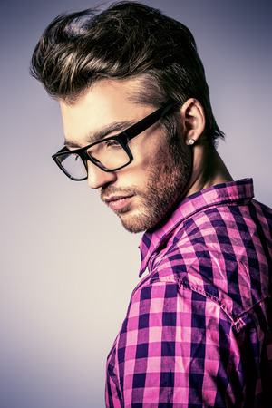 male hair model: Portrait of a modern young man in spectacles. Stock Photo