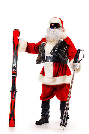 Santa Claus is standing in the ski mask and holding a skiing. Christmas. Isolated over white. Stock Photo
