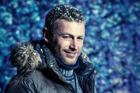brutal: Portrait of a handsome brutal man dressed in winter clothes, covered with frost. Stock Photo