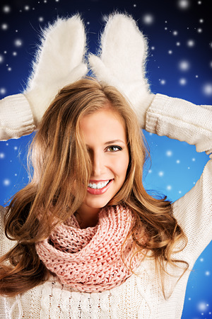 Portrait of a pretty smiling woman in warm clothing. photo