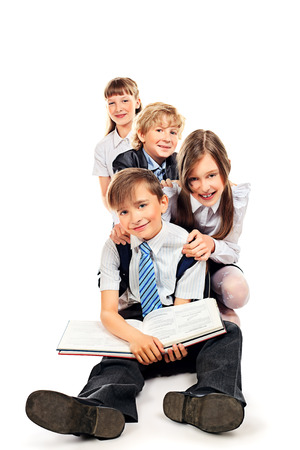 Group of happy students standing together. Education. Isolated over white background. photo
