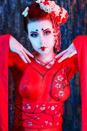 Art portrait of a stylized Japanese geisha. Body painting project.  photo