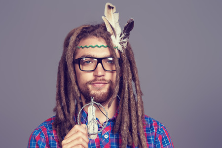 Portrait of a hippie young man in spectacles. photo