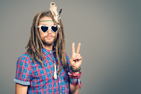 hippie: Portrait of a hippie young man in spectacles. Stock Photo