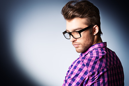 man face profile: Portrait of a modern young man in spectacles. Stock Photo