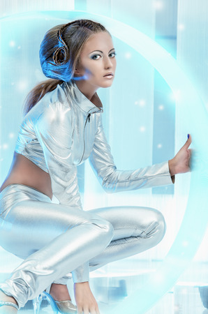 latex woman: Beautiful young woman in silver latex costume with futuristic hairstyle and make-up. Sci-fi style.