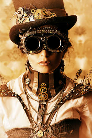 Portrait of a beautiful steampunk woman over vintage . photo