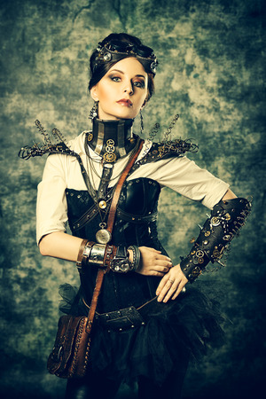 Portrait of a beautiful steampunk woman over grunge background. Stock Photo - 24218953