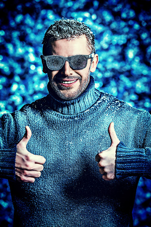 winter clothes: Handsome brutal man dressed in winter clothes covered with frost.  Stock Photo