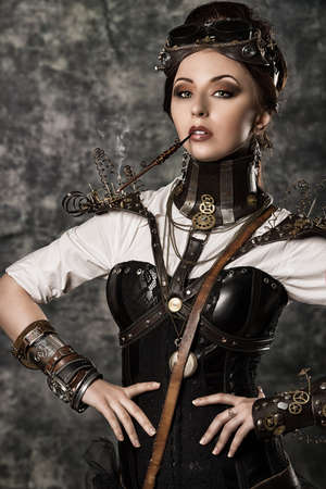 Portrait of a beautiful steampunk woman over grunge background. Stock Photo - 24760623