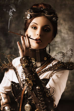 Portrait of a beautiful steampunk woman over grunge background. Stock Photo - 24760663