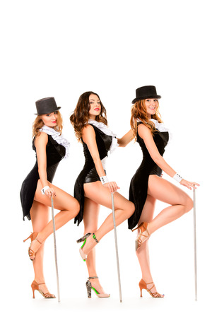 Group of modern professional dancers posing at studio. Isolated over white.