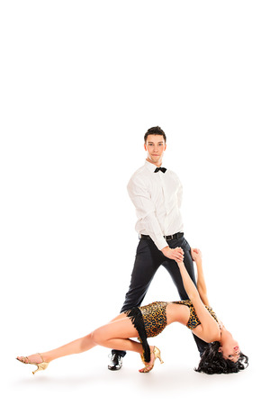 salsa dance: Beautiful professional artists dancing passionate dance. Isolated over white. Stock Photo