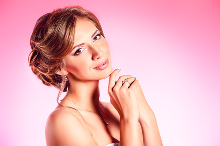 Beautiful young woman smiling at camera over pink . Stock Photo - 24497559