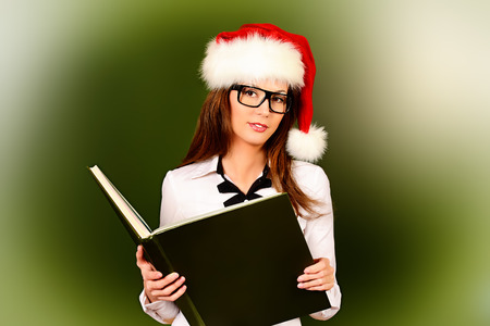 Portrait of a smiling female teacher in Christmas cap.  Education. photo