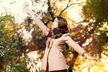 Beautiful young woman at the autumn park. photo