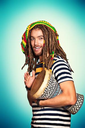 rasta: Portrait of a rastafarian guy playing his drum.