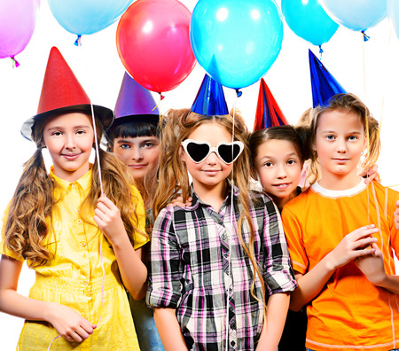 Group of happy kids having fun at a party. Isolated over white. photo