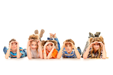 curiously: Group of children curiously looking into the distance. Isolated over white. Stock Photo